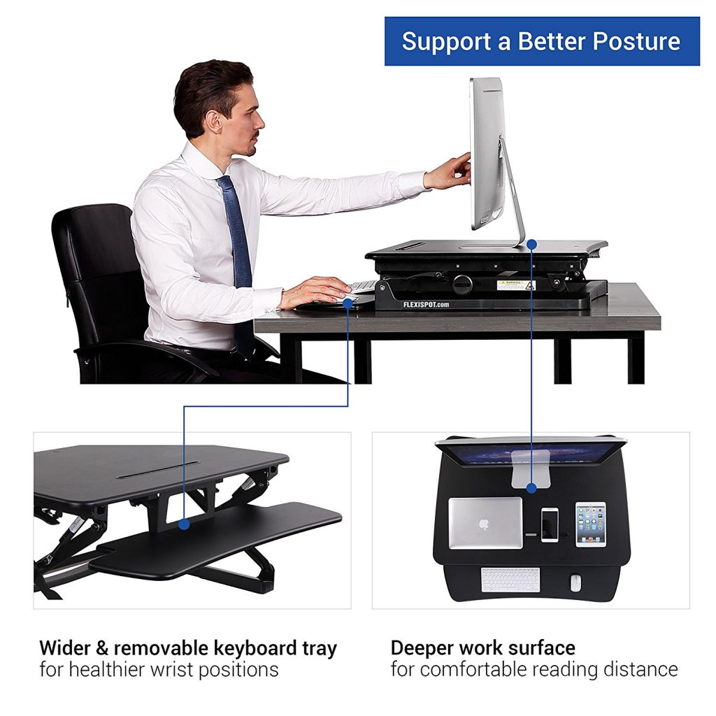 man adjusting monitor on the flexispot standing desk converter