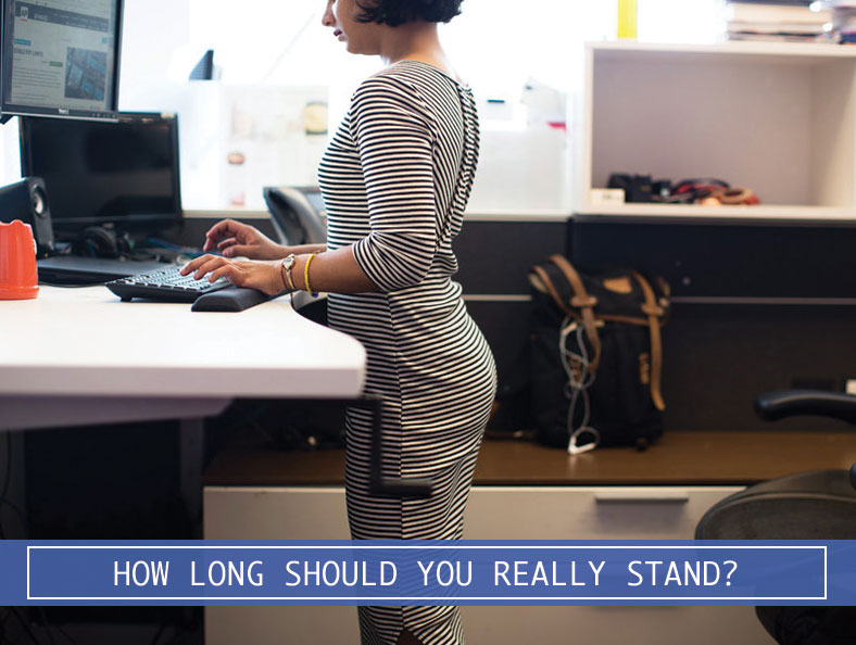 woman working on a computer at a stand up desk