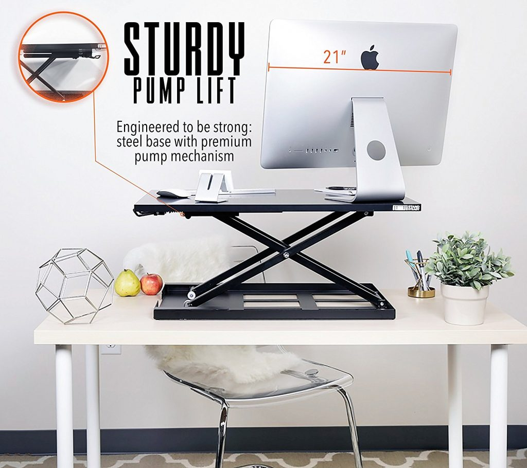 "image of the standing desk with imac and displaying 21"" on the image. the image shows pump lift technology on the elite pro"