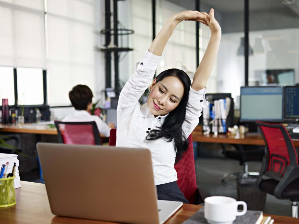 asian woman stretching at work