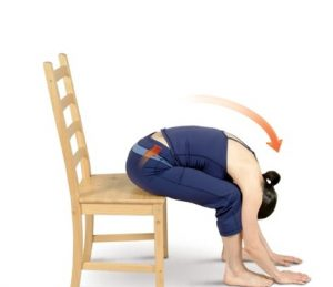 woman showing chair seated forward bend yoga exercise