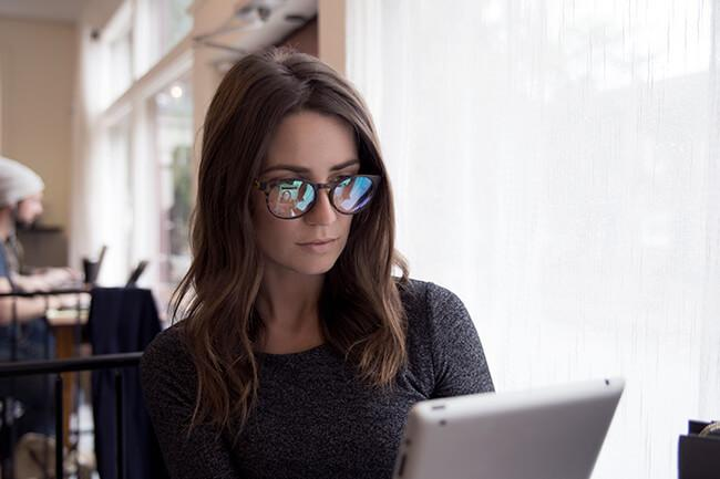 woman wearing protective computer glasses