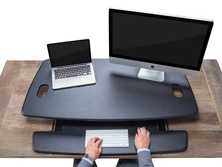 imac and laptop on varidesk pro plus
