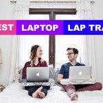 couple on bed with macbook using best cushioned laptop lap tray