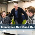 CEO Tim Cook laughing with his employees