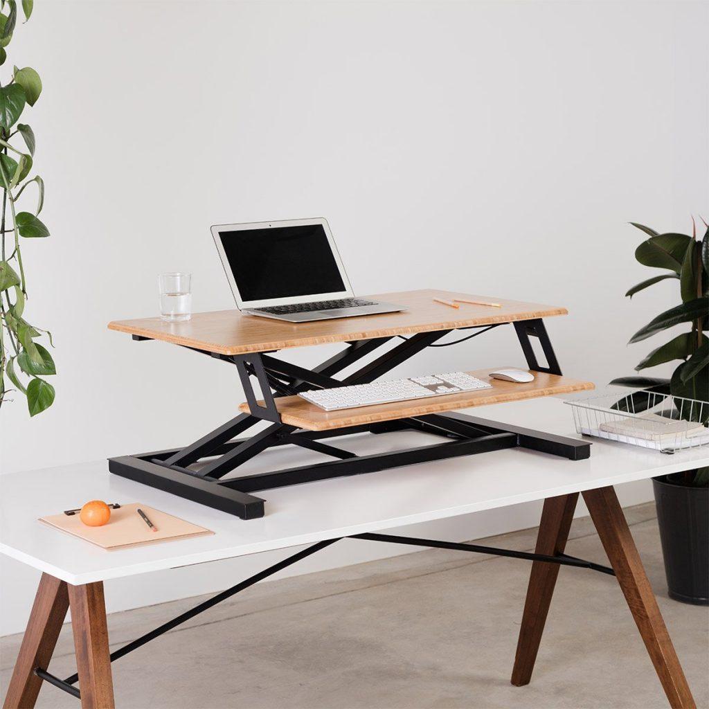 macbook on fully cooper stand up desk converter