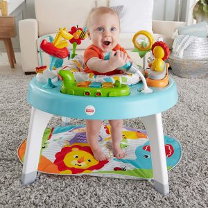 fisher price toddler playing in activity center listening to music