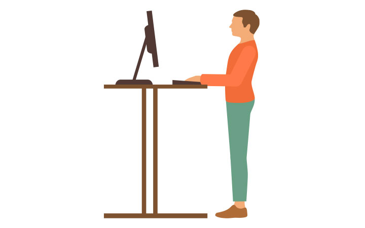 man using stand up station