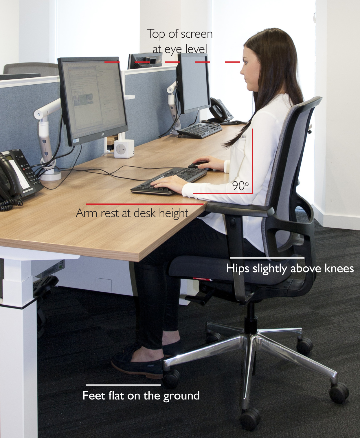 woman correcting seated desk height for better posture and ergonomics