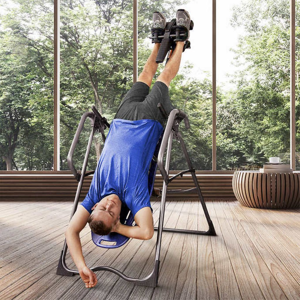 man using the inversion table 45 degrees