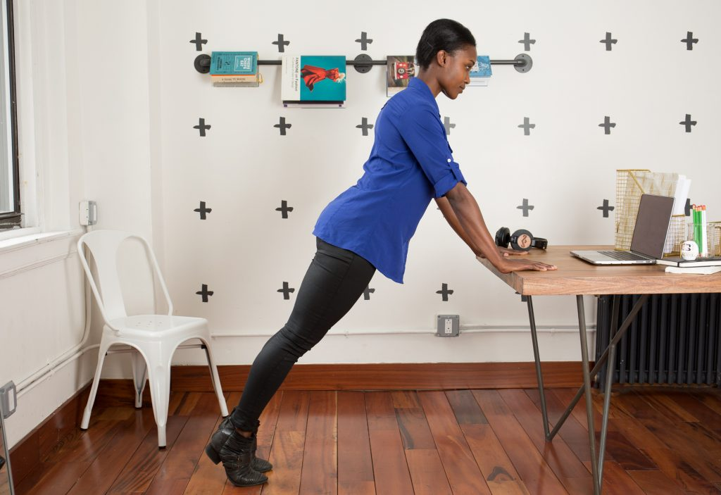 woman exercising at desk to help with shoulder pain