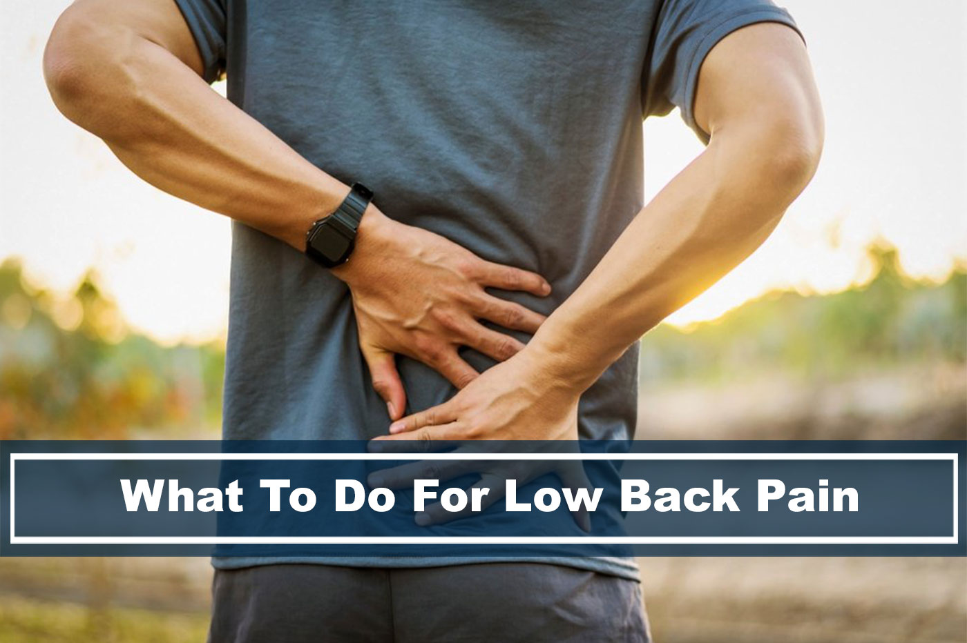 person holding lower back pain
